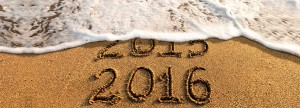 2015 2016 written into sand with wave washing away written 2015