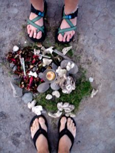 feet encircling found treasures on the beach